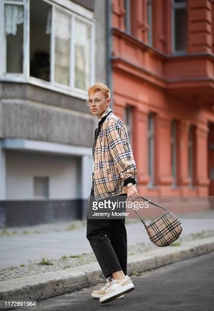 Erik Scholz wearing a Burberry jacket and bag, Nike Air Force Sneaker, Heron Preston belt and Acne Studios shirt on September 04, 2019 in Berlin,...