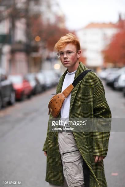 53e236e1d746 Erik Scholz wearing a MCM bag 032c belt Acne Studios shirt Balenciaga  triple S and an