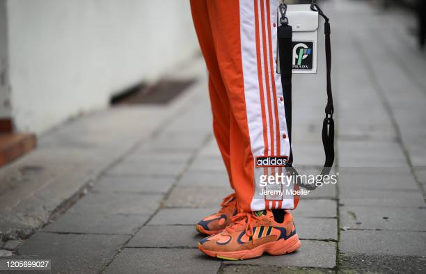 Erik Scholz wearing Adidas trackpants and sneaker, Prada bag, Balenciaga sweater and Daily Paper puffer jacket on February 11, 2020 in Berlin,...