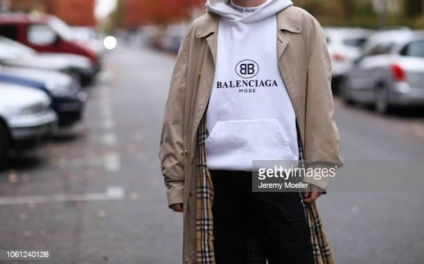 Erik Scholz wearing an Acne Studios shirt Balenciaga hoodie and a Burberry coat on October 28 2018 in Berlin Germany