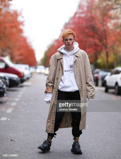 Erik Scholz wearing an Acne Studios shirt Balenciaga hoodie and track shoes and a Burberry coat on October 28 2018 in Berlin Germany
