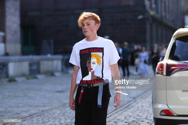 Erik Scholz wearing an Alyx belt and TShirt during the Berlin Fashion Week July 2018 on July 3 2018 in Berlin Germany