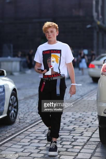 Erik Scholz wearing an Alyx belt and TShirt during the Berlin Fashion Week July 2018 on July 3 2018 in Berlin Germany