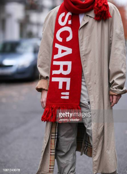 Erik Scholz wearing an Off White scarf and Burberry coat on October 28 2018 in Berlin Germany