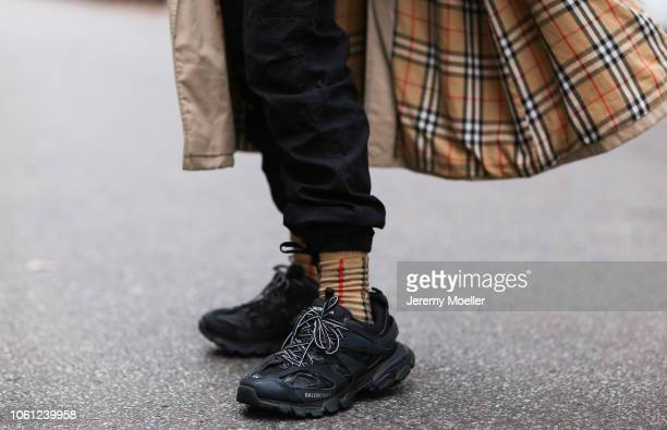 6971fa240150 Erik Scholz wearing Balenciaga track shoes Burberry socks and coat on  October 28 2018 in Berlin