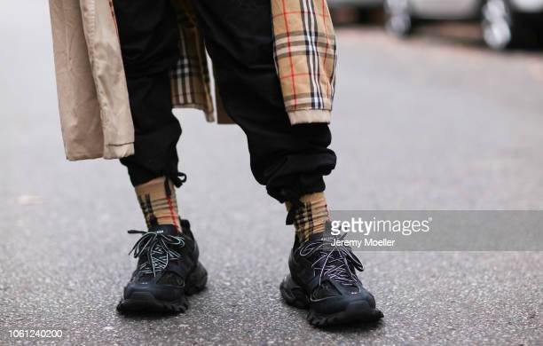 Erik Scholz wearing Balenciaga track shoes Burberry socks and coat on October 28 2018 in Berlin Germany
