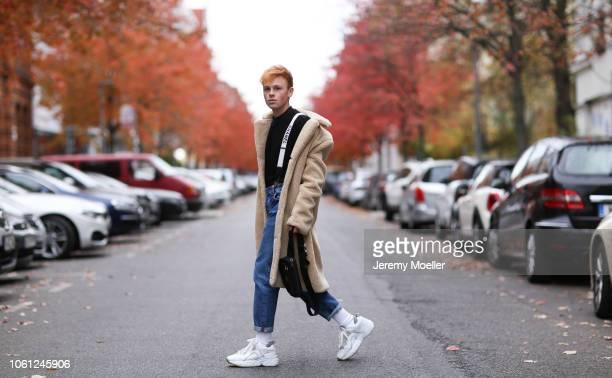 Erik Scholz wearing Chanel suspenders Topman teddy coat Acne Studios sneaker and a Acne Studios shirt on October 28 2018 in Berlin Germany