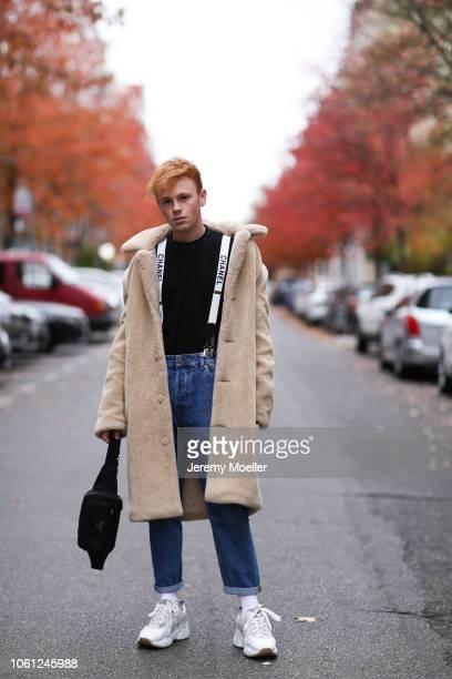 4c09ccbe30fd Erik Scholz wearing Chanel suspenders Topman teddy coat Acne Studios  sneaker and a Acne Studios shirt