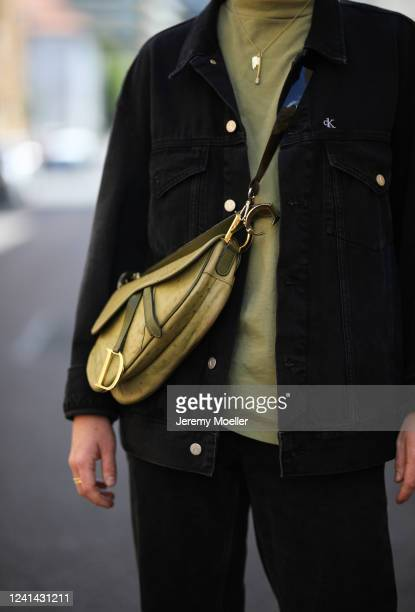 Erik Scholz wearing Dior saddle bag, Calvin Klein jeans jacket, Tommy Hilfiger jeans and Weekday shirt on May 26, 2020 in Berlin, Germany.