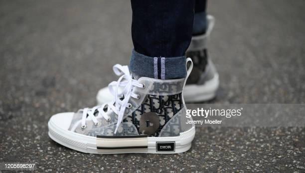 Erik Scholz wearing Dior sneaker and shades Bottega Veneta bag Asos jeans and Topman leather jacket on February 11 2020 in Berlin Germany