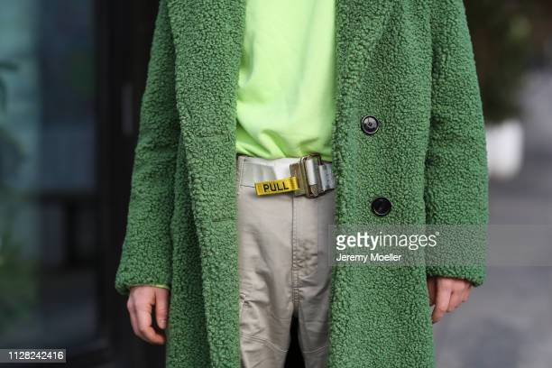 Erik Scholz wearing Zara coat, Gstar cargo pants, Vans shoes, Pull and Bear sweater, Heron Preston belt and a Marc Jacobs glasses on February 08,...