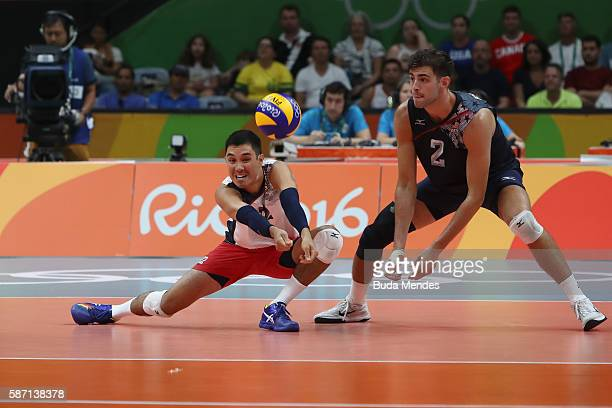Erik Shoji and Aaron Russell of the United States in action during the Men's Preliminary Pool A match between the United States and Canada on Day 2...