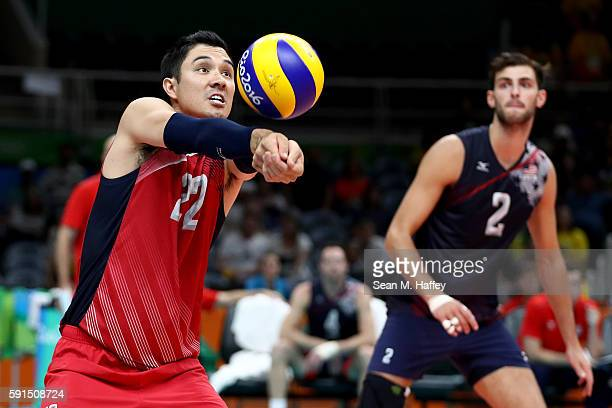 Erik Shoji sets as Aaron Russell of United States looks on against Poland during the Men's Quarterfinal Volleyball match on Day 12 of the Rio 2016...
