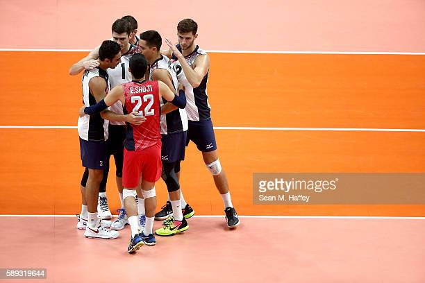 Erik Shoji Taylor Sander Matthew Anderson Aaron Russell and Micah Christenson of United States react against France during a Men's Preliminary Pool B...