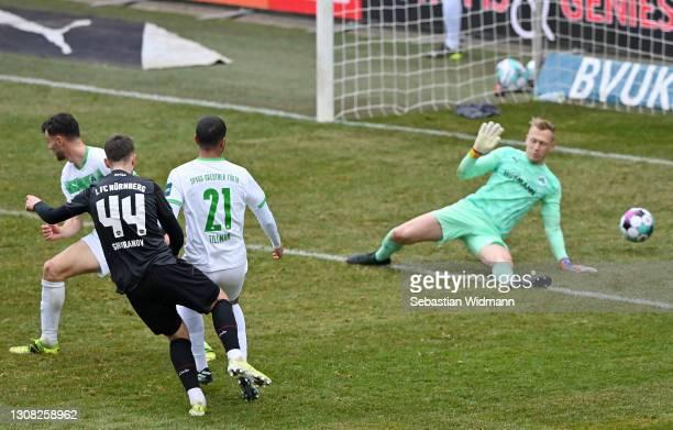 Erik Shuranov of 1.FC Nurnberg scores their side's second goal past Sascha Burchert of SpVgg Greuther Furth during the Second Bundesliga match...