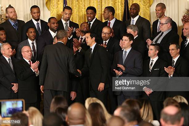 Erik Spoelstra of the Miami Heat and US President Barack Obama smile and pose for pictures during a visit to the White House to celebrate their 2013...