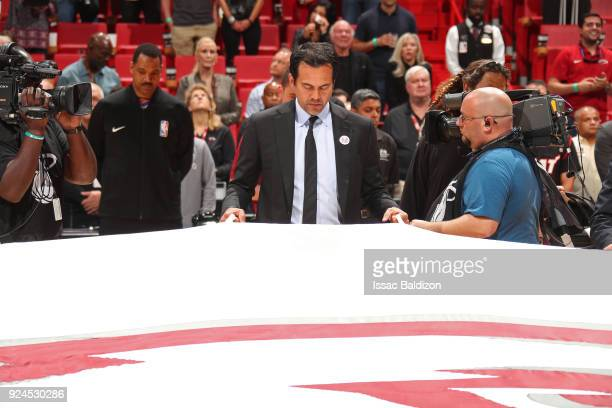 Erik Spoelstra of the Miami Heat holds the Marjory Stoneman Douglas HS flag prior to the game against the Memphis Grizzlies on February 24 2018 at...
