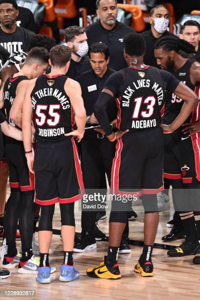Erik Spoelstra of the Miami Heat huddles his team up against the Los Angeles Lakers during Game Four of the NBA Finals on October 6, 2020 in Orlando,...