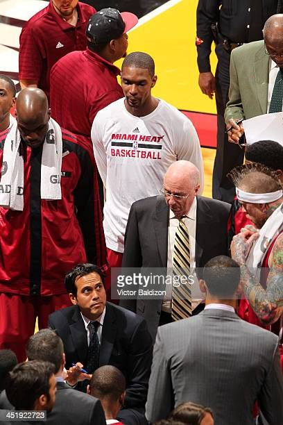 Erik Spoelstra of the Miami Heat speaks with his team during a timeout during the game against the Orlando Magic on November 23 2013 at American...