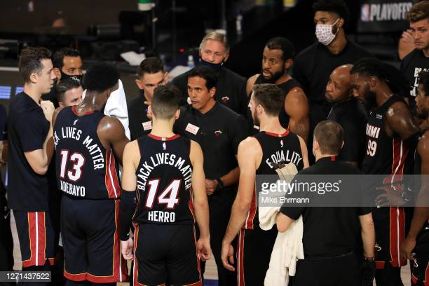 Erik Spoelstra of the Miami Heat talks with his team during the fourth quarter against the Milwaukee Bucks in Game Five of the Eastern Conference...
