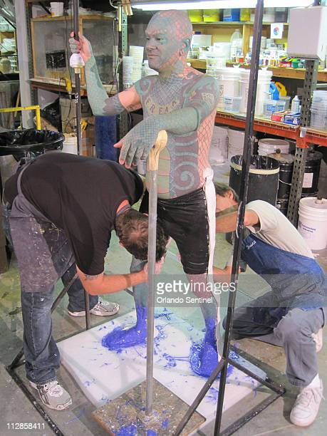 Erik Sprague known as Lizardman stands as artists from Ripley Entertainment apply silicon to his feet in Orlando Florida Tuesday August 17 2010...