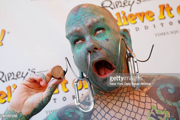 Erik Sprague twists a corkscrew through his nose and out through his mouth during the opening celebration of the new Ripley's Believe It or Not...