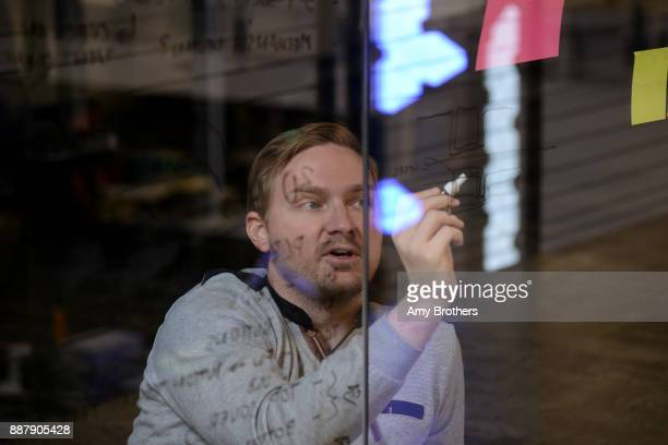Erik Stefansson a Mechanical engineer writes notes during a meeting at the Sphero campus in Boulder Colorado on December 1 2017 Sphero specializes in...
