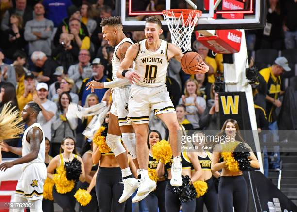Erik Stevenson of the Wichita State Shockers celebrates with teammate Dexter Dennis after the Shockers defeated the Mississippi Rebels 7454 on...