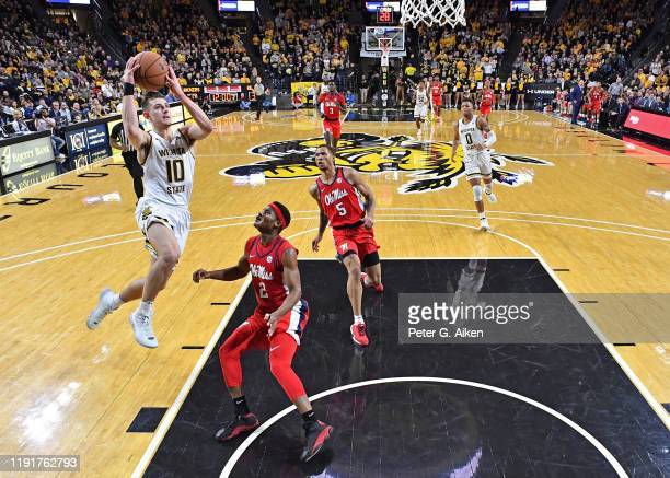 Erik Stevenson of the Wichita State Shockers drives to the basket against Devontae Shuler of the Mississippi Rebels during the second half on January...