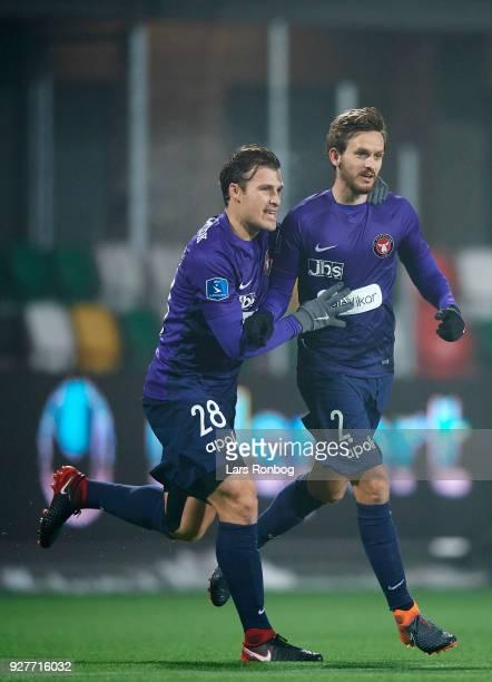 Erik Sviatchenko and Kian Hansen of FC Midtjylland celebrate after scoring their first goal during the Danish Alka Superliga match between Silkeborg...