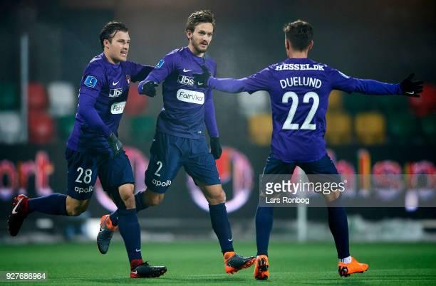 Erik Sviatchenko Kian Hansen and Mikkel Duelund of FC Midtjylland celebrate after scoring their first goal during the Danish Alka Superliga match...