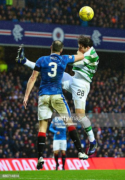 Erik Sviatchenko of Celtic and Clint Hill of Rangers compete for the ball during the Ladbrokes Scottish Premiership match between Rangers and Celtic...