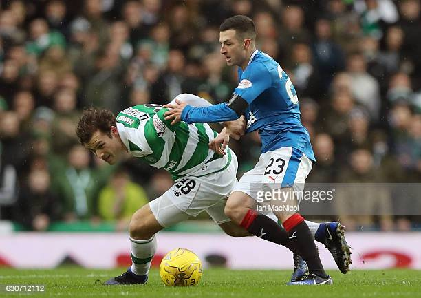Erik Sviatchenko of Celtic and Jason Holt of Rangers compete for the ball during the Ladbrokes Scottish Premiership match between Rangers and Celtic...