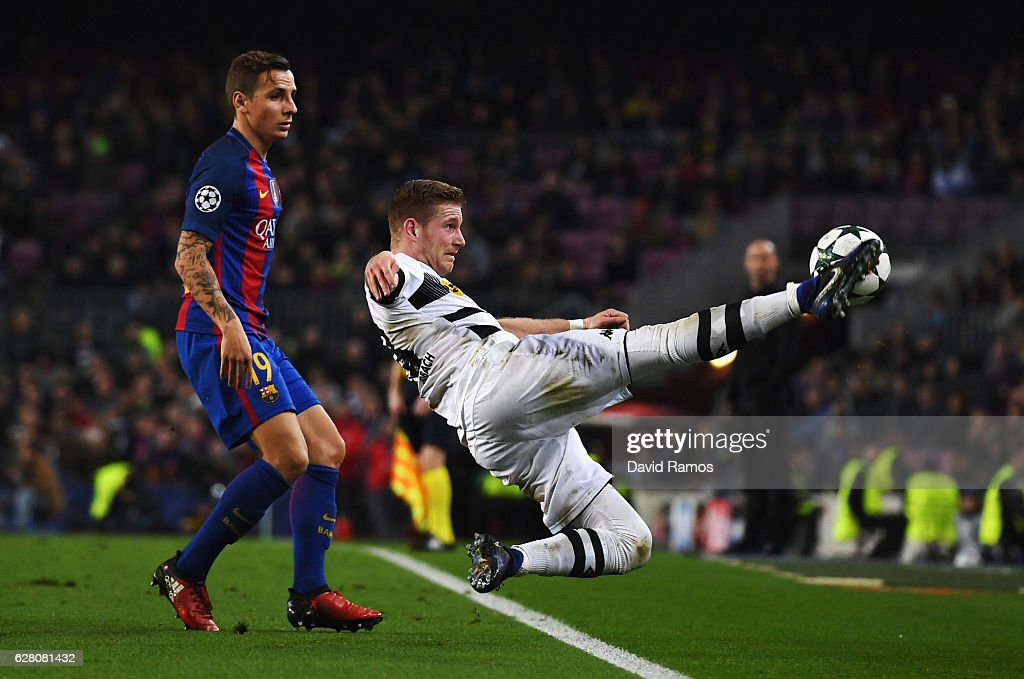 Erik Sviatchenko of Celtic (R) attempts to keep the ball in while Lucas Digne of Barcelona (L) looks on during the UEFA Champions League Group C match between FC Barcelona and VfL Borussia Moenchengladbach at Camp Nou on December 6, 2016 in Barcelona, .