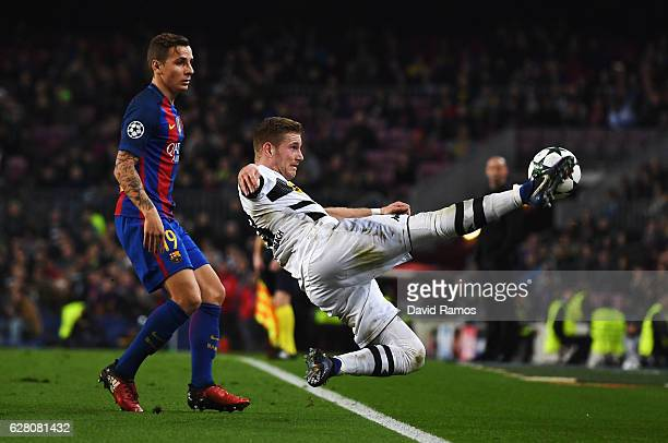 Erik Sviatchenko of Celtic attempts to keep the ball in while Lucas Digne of Barcelona looks on during the UEFA Champions League Group C match...