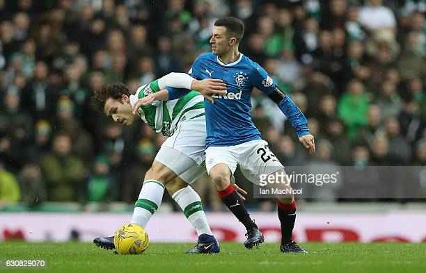 Erik Sviatchenko of Celtic vies with Jason Holt of Rangers during the Rangers v Celtic Ladbrokes Scottish Premiership match at Ibrox Stadium on...