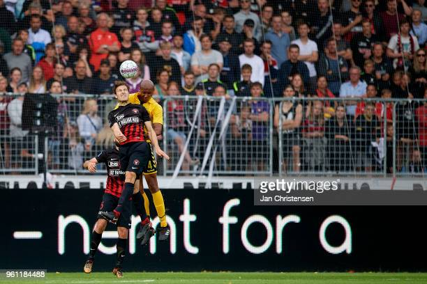 Erik Sviatchenko of FC Midtjylland and Ayo Simon Okosun of AC Horsens compete for the ball during the Danish Alka Superliga match between FC...