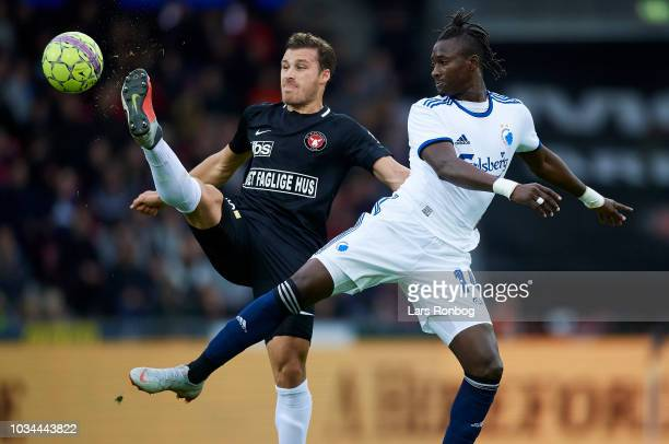 Erik Sviatchenko of FC Midtjylland and Dame N'Doye of FC Copenhagen compete for the ball during the Danish Superliga match between FC Midtjylland and...