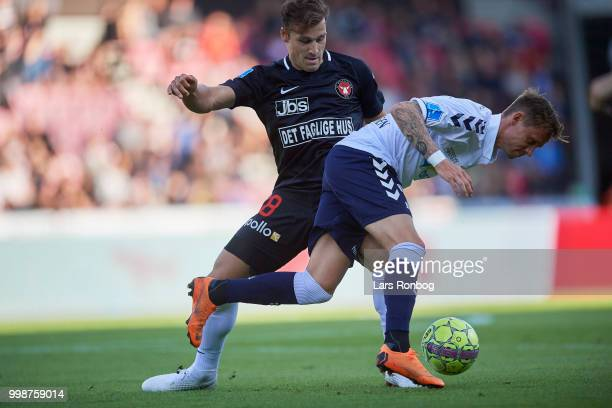 Erik Sviatchenko of FC Midtjylland and Jakob Ankersen of AGF Aarhus compete for the ball during the Danish Superliga match between FC Midtjylland and...