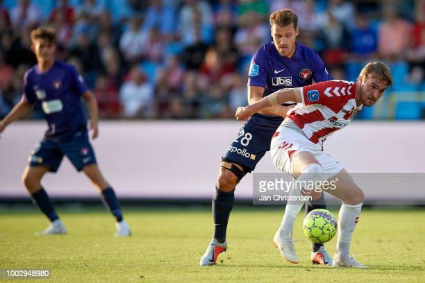 Erik Sviatchenko of FC Midtjylland and Jannik Pohl of AaB Aalborg compete for the ball during the Danish Superliga match between AaB Aalborg and FC...