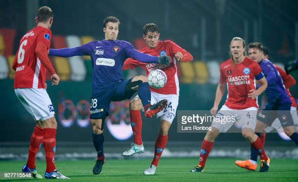 Erik Sviatchenko of FC Midtjylland and Jeppe Gertsen of Silkeborg IF compete for the ball during the Danish Alka Superliga match between Silkeborg IF...