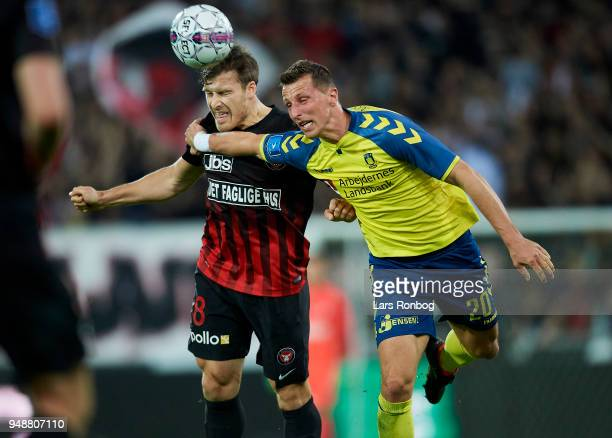 Erik Sviatchenko of FC Midtjylland and Kamil Wilczek of Brondby IF compete for the ball during the Danish Alka Superliga match between FC Midtjylland...