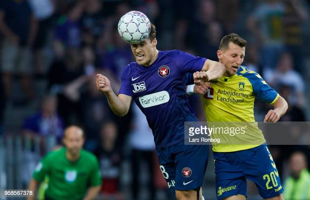 Erik Sviatchenko of FC Midtjylland and Kamil Wilczek of Brondby IF compete for the ball during the Danish Alka Superliga match between Brondby IF and...