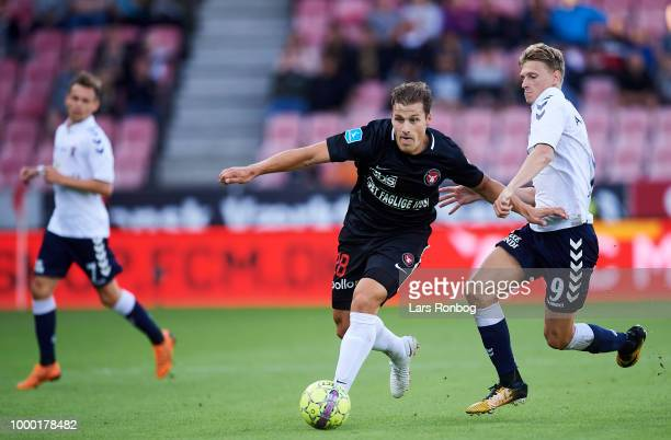 Erik Sviatchenko of FC Midtjylland and Kasper Junker of AGF Aarhus compete for the ball during the Danish Superliga match between FC Midtjylland and...