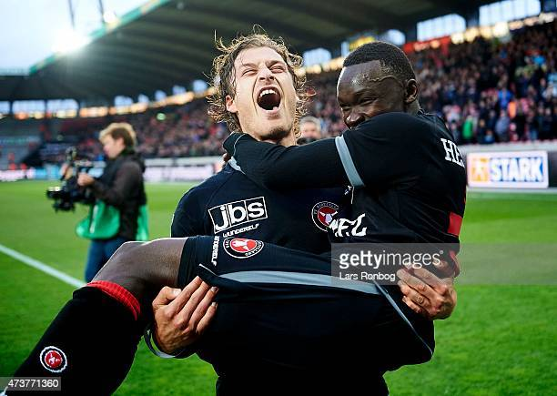 Erik Sviatchenko of FC Midtjylland and Pione Sisto of FC Midtjylland celebrate their victory after the Danish Alka Superliga match between FC...