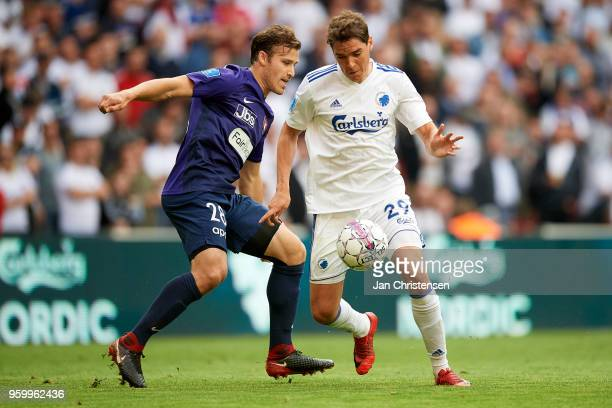 Erik Sviatchenko of FC Midtjylland and Robert Skov of FC Copenhagen compete for the ball during the Danish Alka Superliga match between FC Copenhagen...