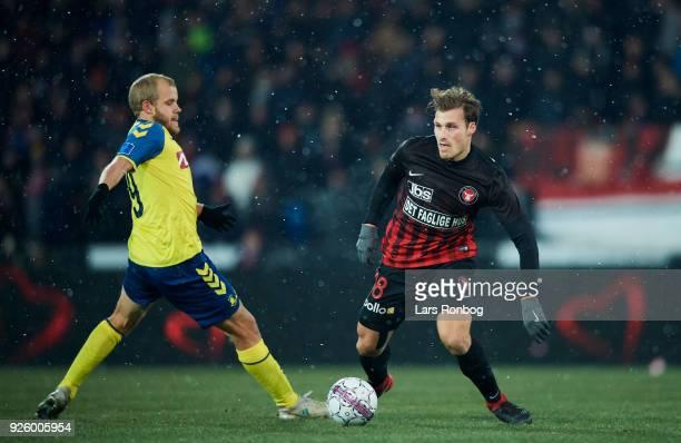 Erik Sviatchenko of FC Midtjylland and Teemu Pukki of Brondby IF compete for the ball during the Danish Alka Superliga match between FC Midtjylland...