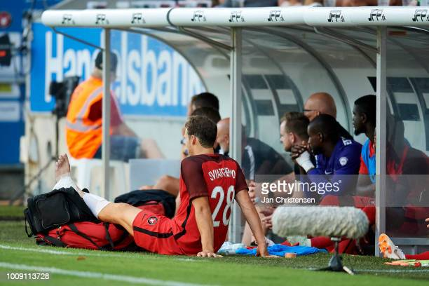 Erik Sviatchenko of FC Midtjylland get an injury during the UEFA Champions League Qualification 2nd Leg match between FC Midtjylland and FC Astana at...