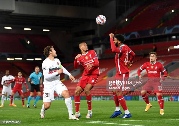 Erik Sviatchenko of FC Midtjylland looks on with Fabinho Joe Gomez and Xherdan Shaqiri of Liverpool during the UEFA Champions League Group D stage...