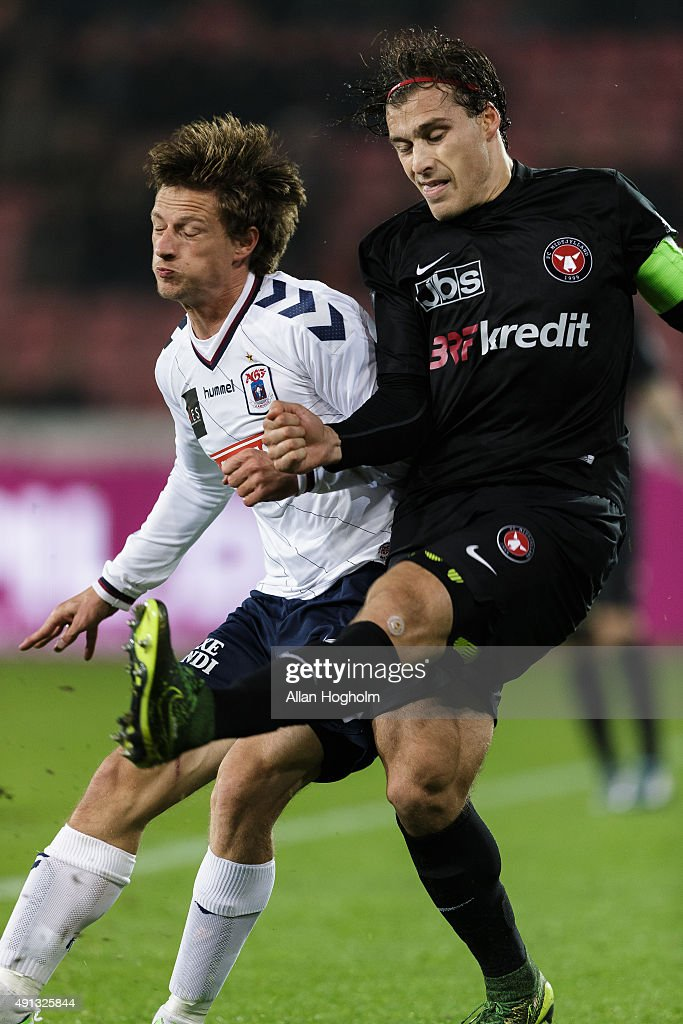 Erik Sviatchenko of Midtjylland and Jesper Lange of AGF Aarhus compete for the ball during the Danish Alka Superliga match between FC Midtjylland and AGF Aarhus at MCH Arena on October 4, 2015 in Herning, Denmark.